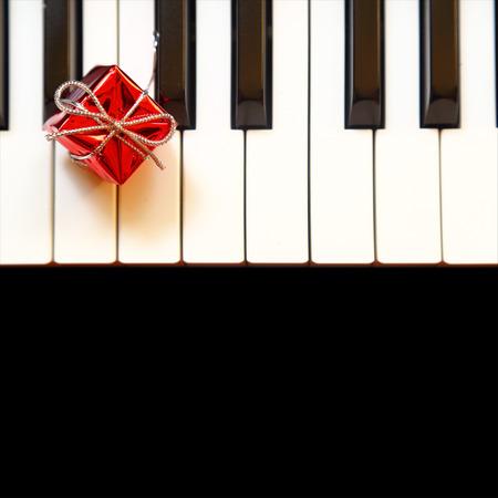 Gift box on piano keys Stock Photo