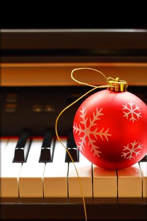 xmas card: Christmas ball on piano keys