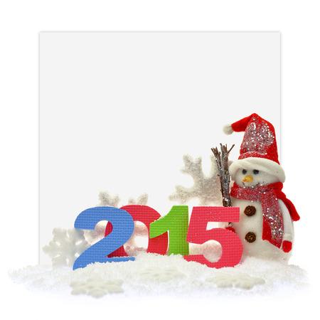 nouvel an: Bonhomme de neige et nouvelle ann�e 2015 en face d'une carte de papier Banque d'images