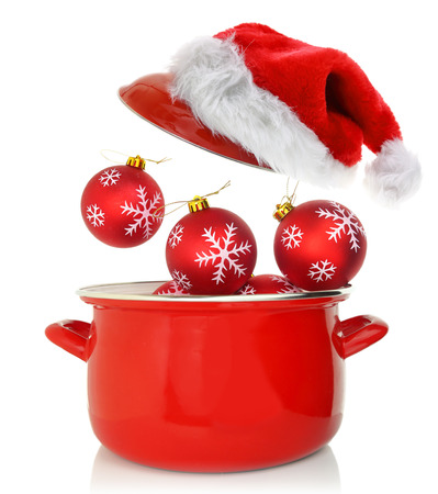 Cooking pot with Christmas ornaments and santas hat photo