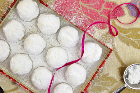 greek food: Christmas butter cookies with white sugar powder in a box Stock Photo