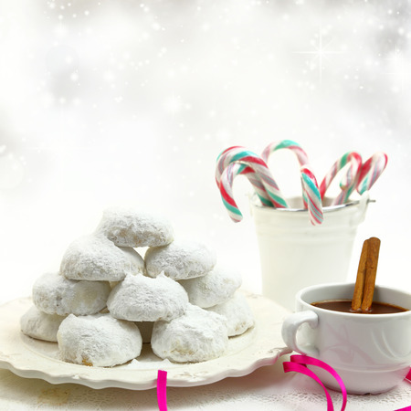 Christmas cookies with candies and coffee on white bokeh background photo