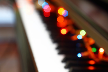 Abstract Christmas musical background with piano and lights. photo