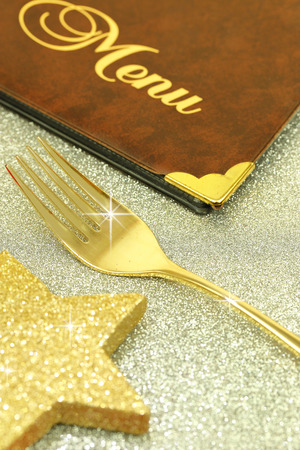 christmas menu: Golden fork and restaurant menu on festive background