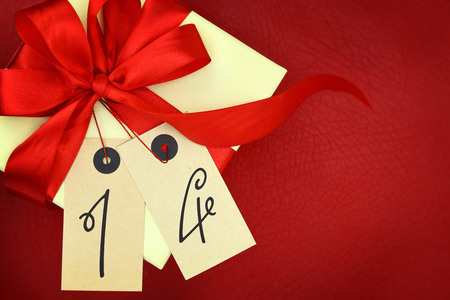 number 14: Gift box with number 14 and ribbon on red background Stock Photo