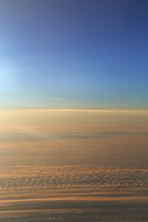 Blue sky over the surface of orange clouds, aerial photography photo