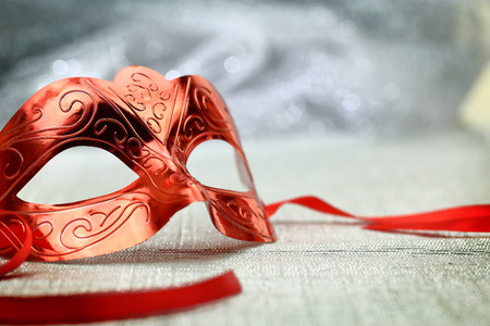 theater mask: Vintage carnival mask in front of glittering background