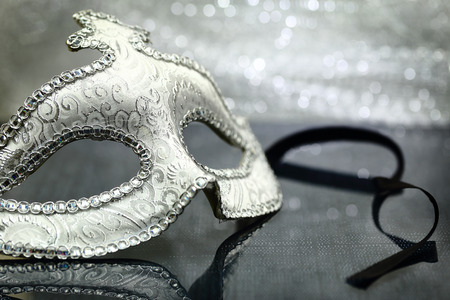 opera: Vintage carnival mask in front of glittering background