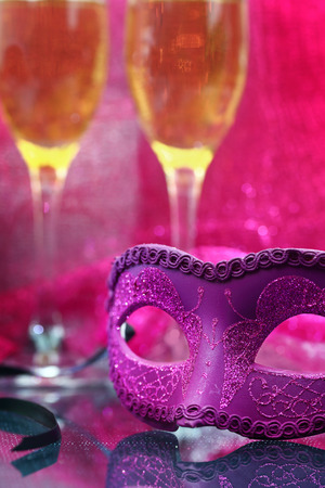 venetian: Vintage carnival mask in front of champagne glasses Stock Photo