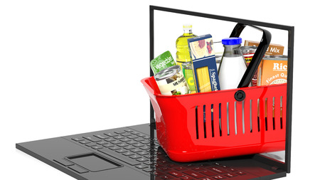 hand basket: Shopping hand basket full with products on laptop, isolated Stock Photo