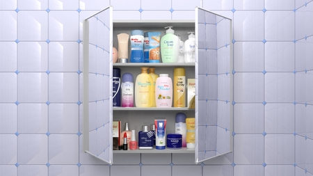 business products: Various cosmetics and personal care products in bathroom cabinet Stock Photo