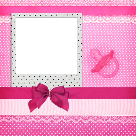 polka dots background: Photo frame and pink pacifier on polka dots background
