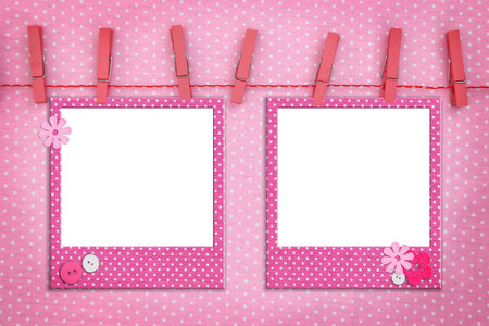 polka dot fabric: Pink photo frames hanging on a rope