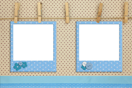 Blue photo frames hanging on a rope photo