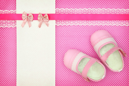 Baby shoes and blank banner on polka dots background Stock Photo
