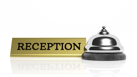 Hotel reception bell and Reception card isolated on white photo