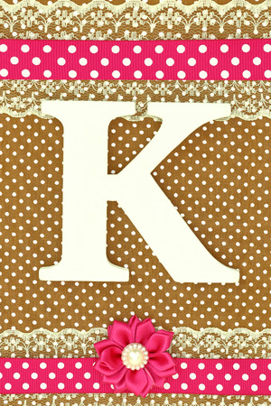 polka dots background: Wooden letter K on polka dots background Stock Photo