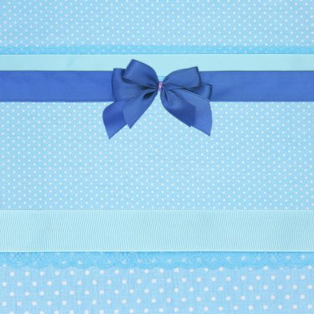 battesimo: Blue retro polka dot sfondo tessile con nastri e fiocco