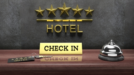 hotel booking: Hotel reception bell and and key on reception wooden desk