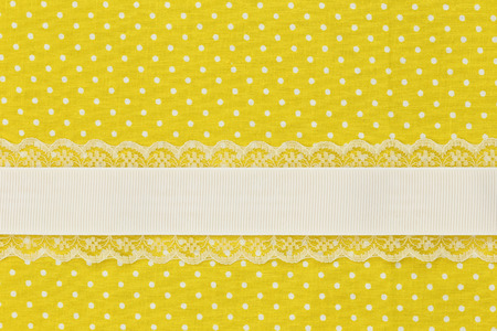 yellow ribbon: Yellow retro polka dot textile background with ribbon