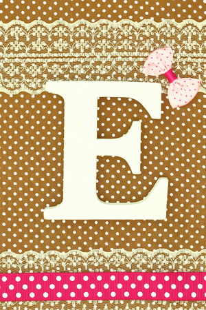 e card: Wooden letter E on polka dots background Stock Photo