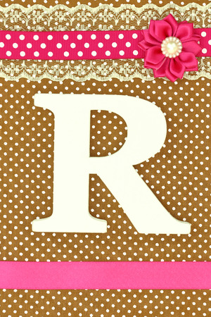 polka dots background: Wooden letter Ron polka dots background