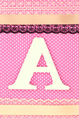 baby romantic: Wooden letter A on polka dots background