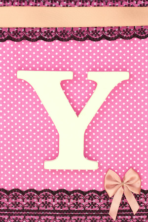 Wooden letter Y on polka dots background photo