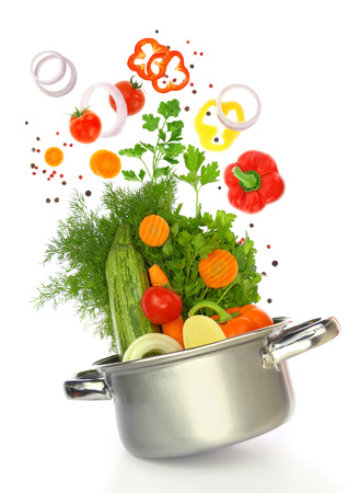 Fresh vegetables coming out of a cooking pot Stock Photo
