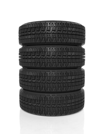 Stack of four black tires isolated on white background photo