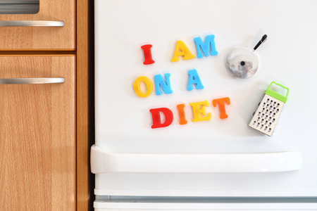 Refrigerators door with colorful text I Am On Diet Diet 免版税图像 - 36950037