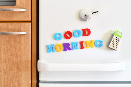 refrigerator with food: Refrigerators door with colorful text Good Morning