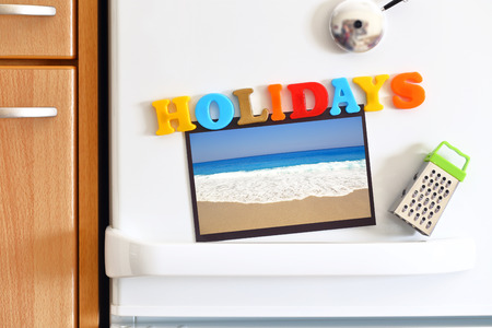 Refrigerators door with colorful text Holidays and Beach Photo