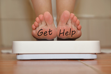 get help: Feet on bathroom scale with hand drawn Get Help text