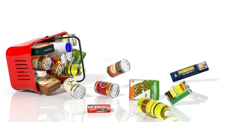 Full shopping basket with products falling out isolated on white Standard-Bild