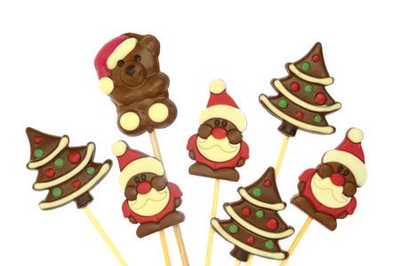 cioccolato natale: Festive cioccolato confetteria Natale su un bastone isolato su bianco Archivio Fotografico