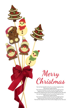 Festive Christmas chocolate confectionery on a stick isolated on white photo