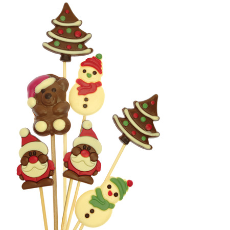 Festive Christmas chocolate confectionery on a stick isolated on white Stock Photo