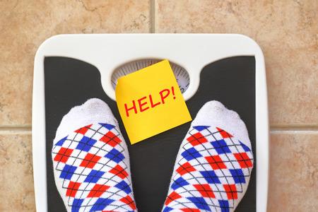 Woman's feet on bathroom scale. Diet concept