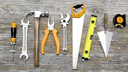 nailed: Various tools nailed on wooden wall
