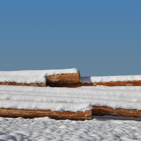 snowbanks: Timber stacks on snow