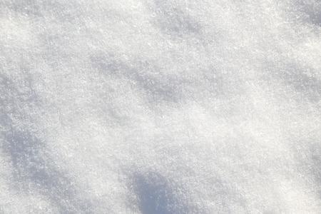 Shiny white soft snow closeup texture