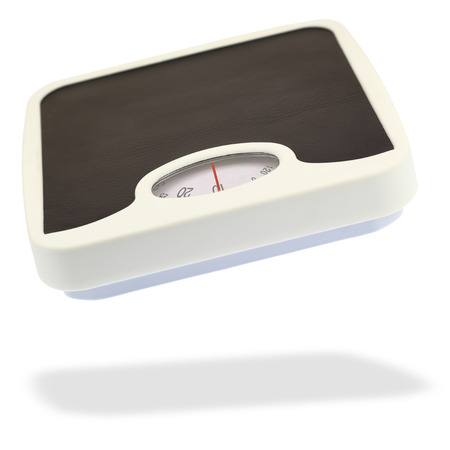 Bathroom scale jumping in the air, on white with shadow photo