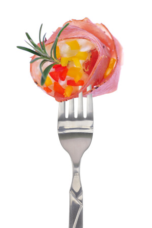 close up food: Fresh colorful composition with prosciutto on fork, isolated on white