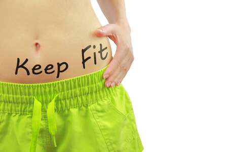 keep fit: Womans fit belly with Keep Fit text, isolated on white