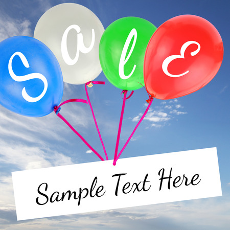 Balloons with Sale text and copy-space on blue sky photo