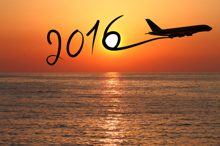 wish: New year 2016 drawing by airplane on the air at sunset