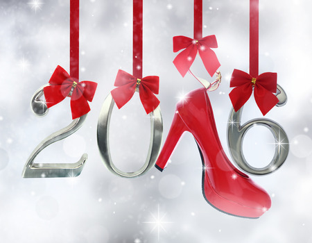 red glittery: High heel shoe and 2016 number hanging on red ribbons in a glittery background Stock Photo