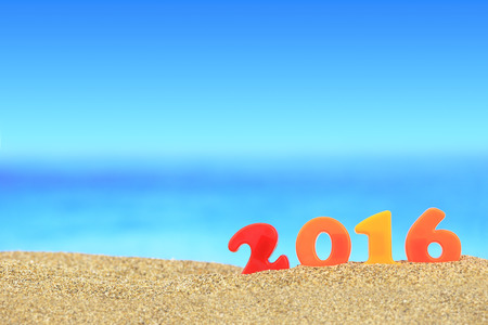 sand sea: New year number 2016 on the beach