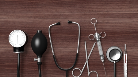 Various medical equipment on wooden background Foto de archivo